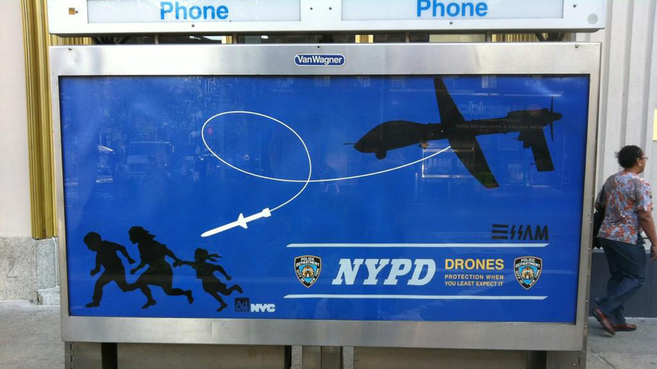 "Essam Attia's satirical anti-drone poster which he distributed around the streets of New York in December 2012. The small strap-line – bottom right -- reads ""NYPD Drones: Protection When You Least Expect It' via 12ozprophet.com"