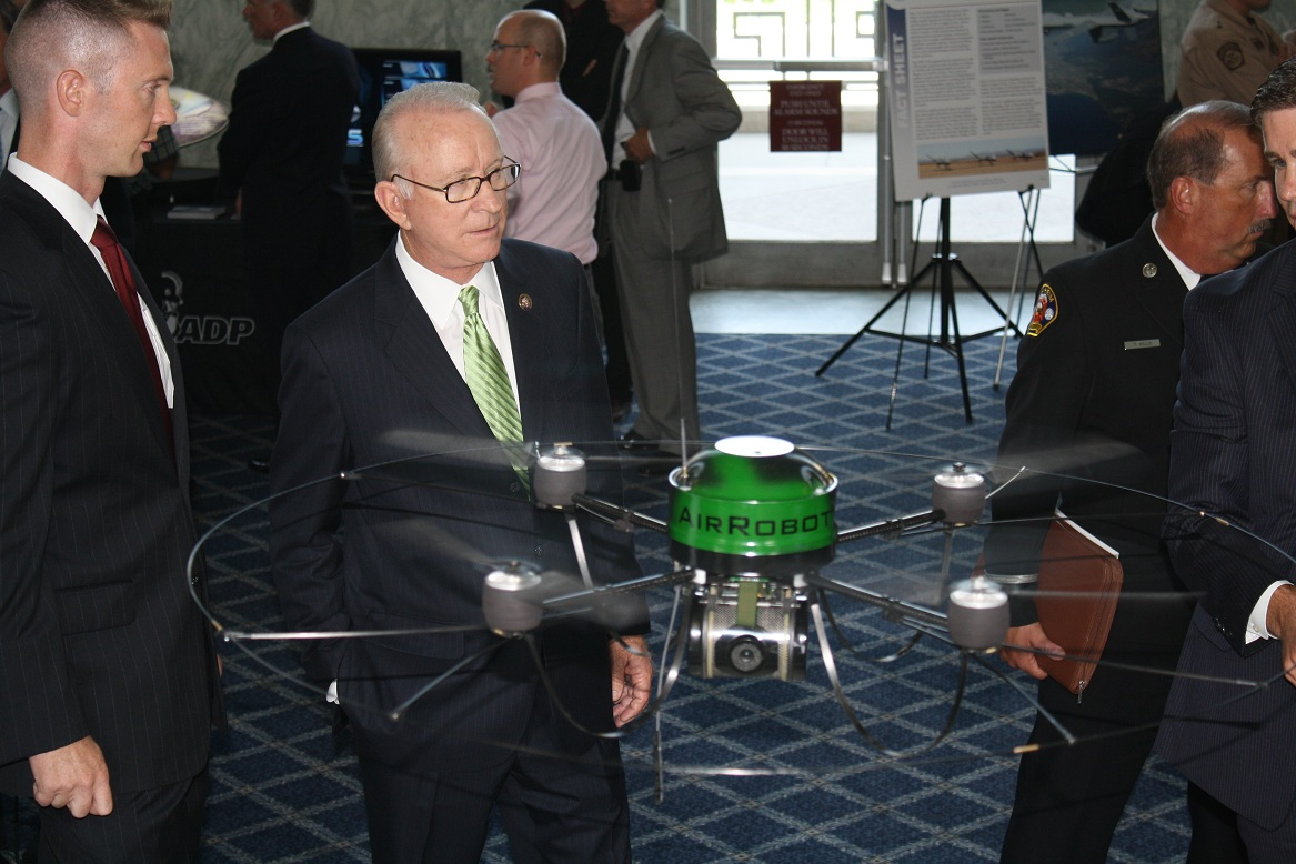 Members of the U.S. Congressional Caucus on Unmanned Systems (CCUS) at a drone demonstration in 2013