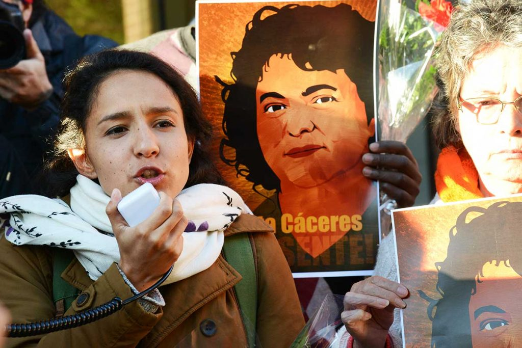 Bertha Caceres speaking outside OAS, 25 April 2016 with a poster of her mother behind her.