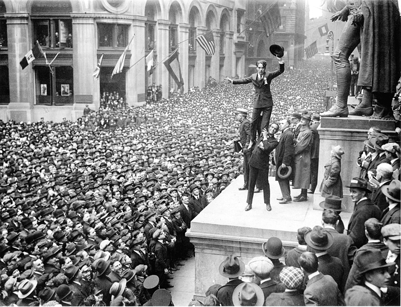 Charlie Chaplin stands on Douglas Fairbanks' shoulders during a Liberty bonds rally. Liberty bonds were war bonds sold to support the allied cause in World War I. The bonds introduced the idea of financial securities to many citizens for the first time. Credit: Wikimedia/Public Domain images for the New York Times